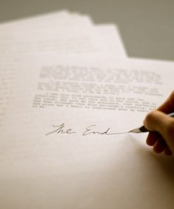 "hand writing ""The End"" on a manuscript--with a fountain pen :)"